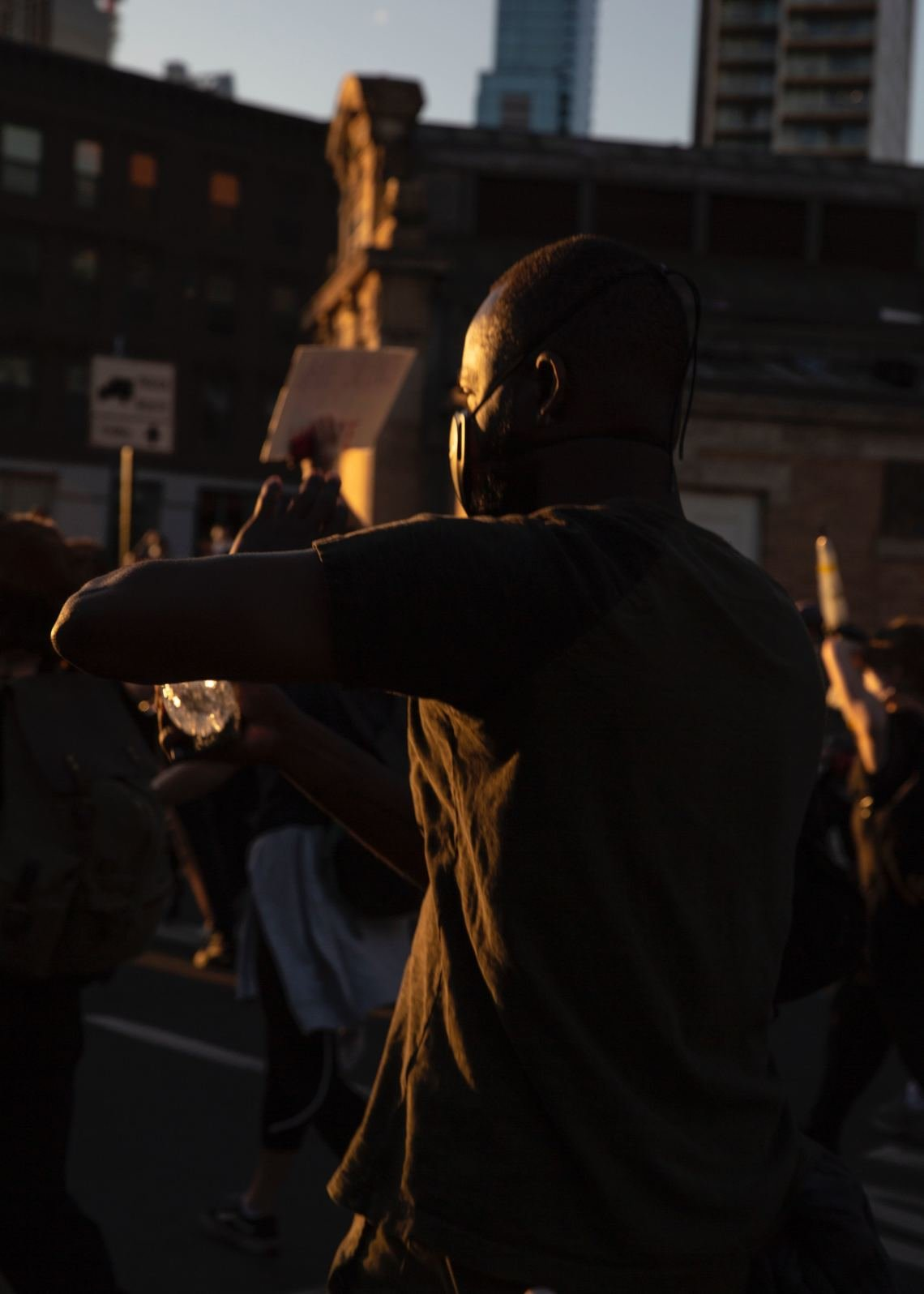 A protester makes his way toward the Manhattan Bridge from the Barclays Center in Brooklyn on Sunday, during protests that brought thousands to the streets.
