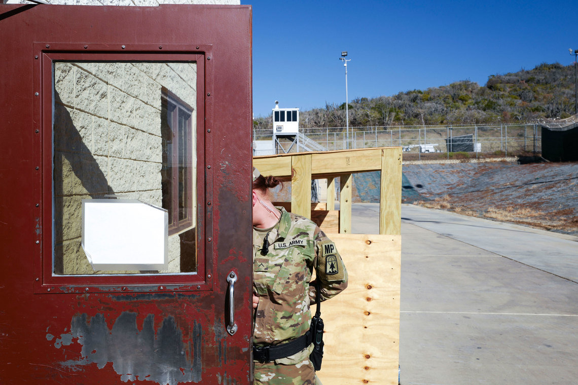 A prison guard outside of Camp 6 at Guantánamo Bay. Under the government's ground rules, no identifiable faces of guards can be shown.