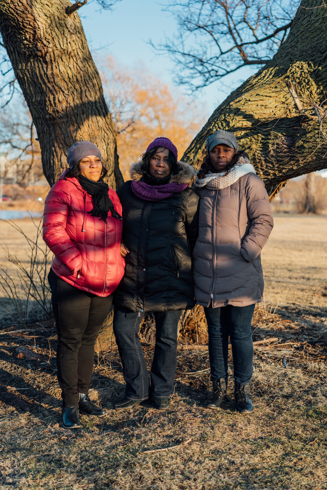 Simmons' sisters in January. From left, Tiffany Ryan, Debra Simmons, and Renesa Peterson stand at the tree in Washington Park in Chicago where they scattered their parents' and brother's ashes.