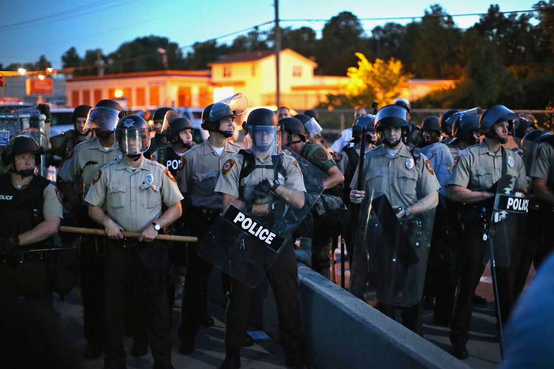 Police in Ferguson, Mo., stood watch on Aug. 13 as protesters gathered four days after Michael Brown's death.