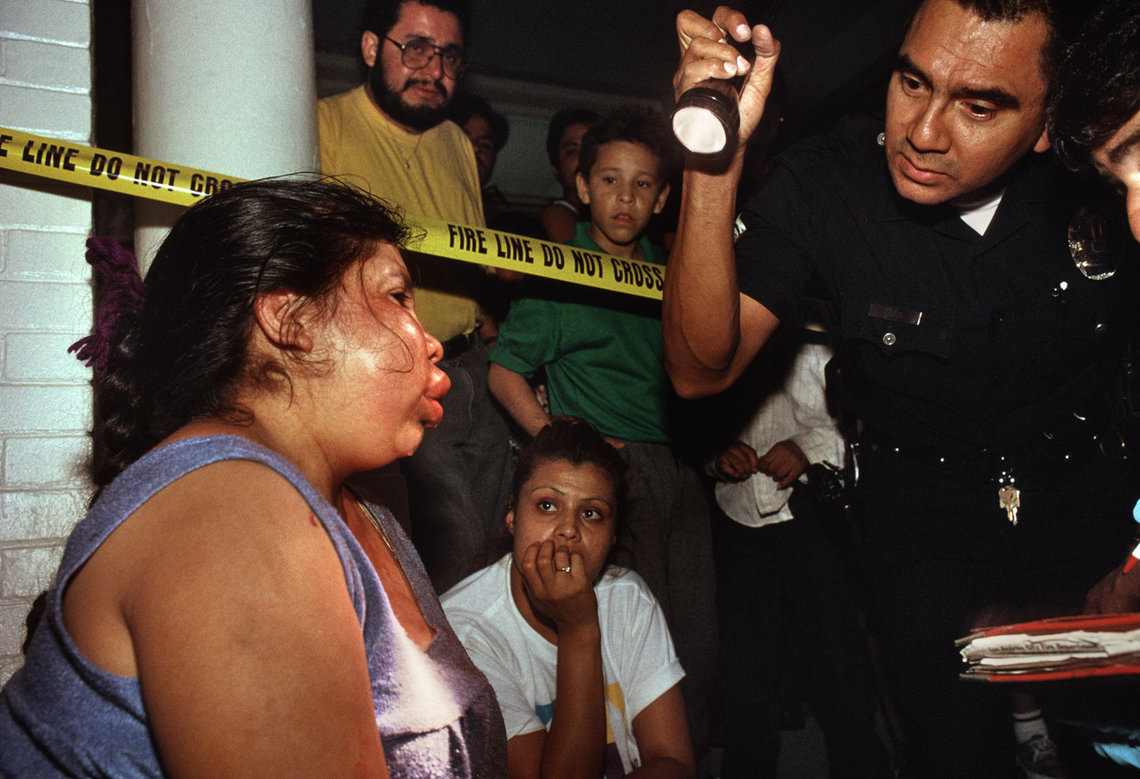 An LAPD officer responds to a domestic violence call in Los Angeles in September 1994.
