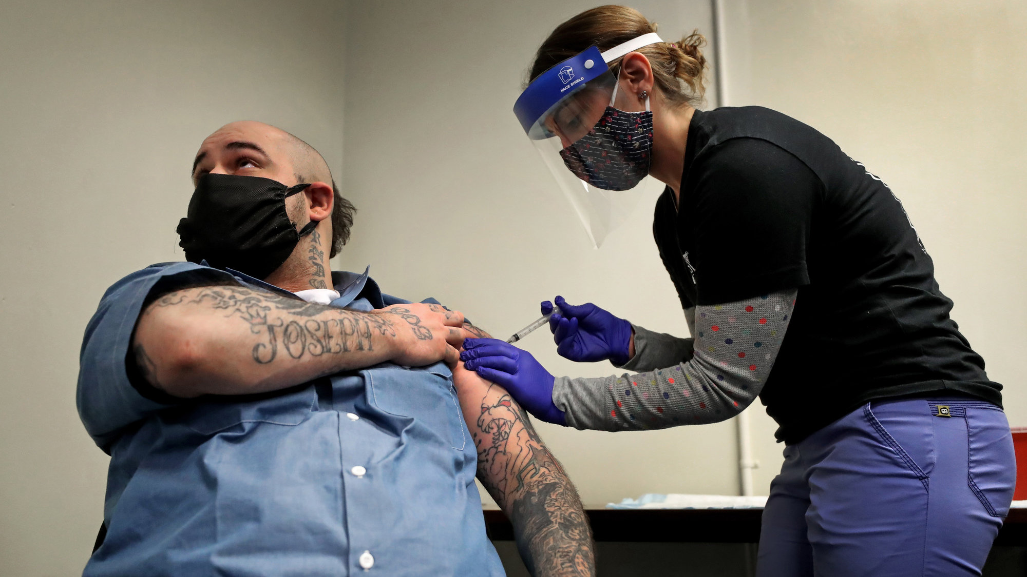 Christian Millett gets the first of two COVID-19 vaccine shots from Alyssa Dobbs, a contractor in the medical department at the Worcester County House of Corrections in West Boylston, Mass., in January.