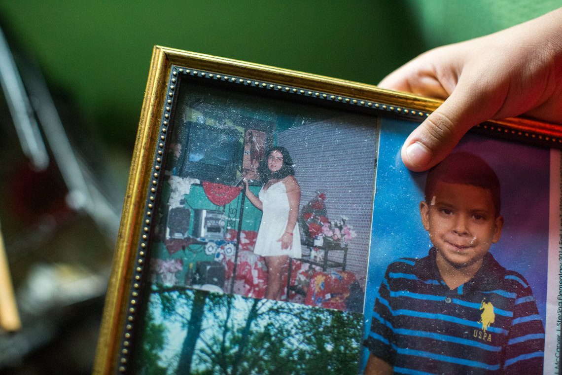 A photo of Arita from when she was living in Honduras, next to a school photo of her son, Amilcar.