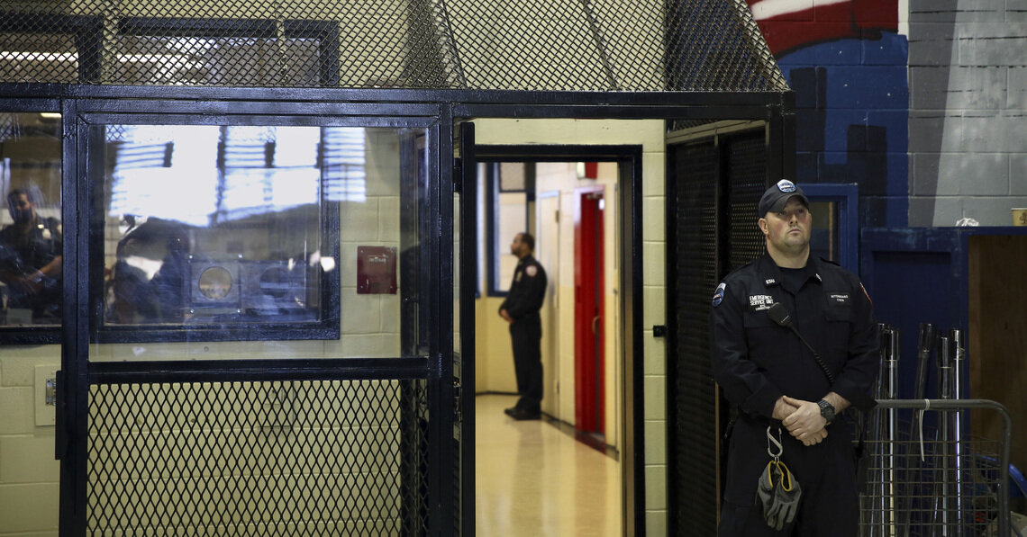Corrections officers stand guard at a unit at the Rikers Island jail complex in New York, March 12, 2015.